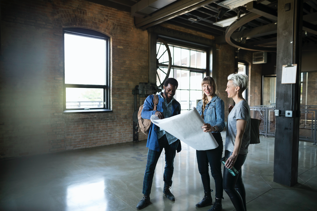 Managers looking at new industrial open office plan